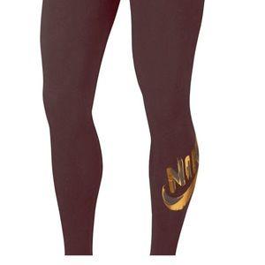 Black with gold logo women's Nike leggings